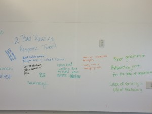A white board with student writing, showing criteria for poor tweeting. 1 of 2.