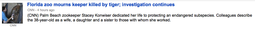 Headline describes a zookeeper who was killed by a tiger; she is described as a wife, daughter, and sister to her coworkers.
