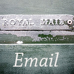 stamped metal sign reading royal mail on green wood background